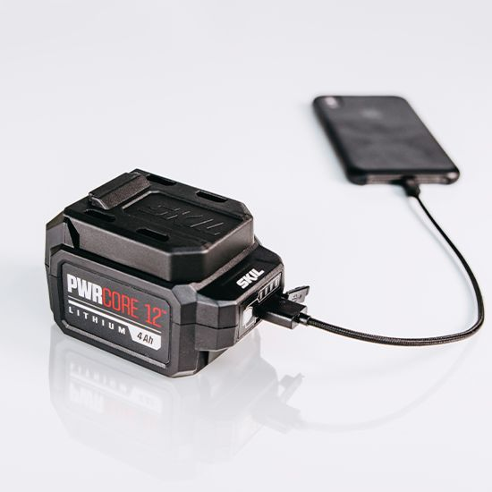 PWR CORE 12™ Lithium 4.0Ah 12V Battery with PWR ASSIST™ Mobile Charging in scene