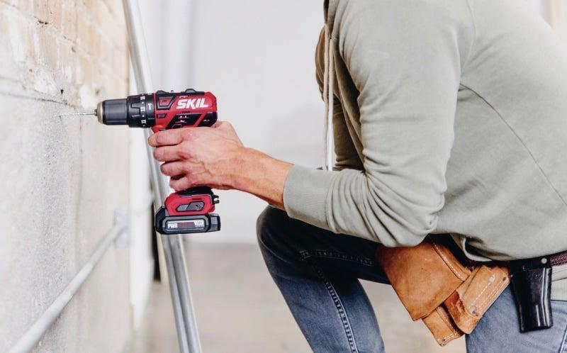 Man using a SKIL drill