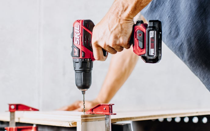 Man using a PWR CORE 12™ drill